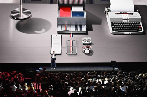 "Hirst introduces the crowd to the Galaxy Z Flip Thom Browne Edition. Created in partnership with the renowned fashion designer, the device proves once and for all that ""high fashion and high-tech go hand in hand."""