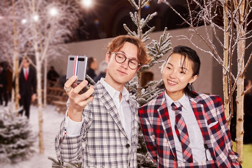 YouTuber Sundy Jules (left) and Model Xiao Wen Ju (right) with Galaxy Z Flip Thom Browne Edition at Paris Fashion Week.