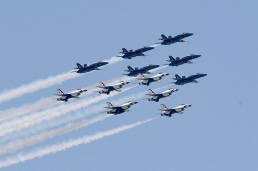 The USN's Blue Angels and USAF's Thunderbirds aerobatic teams flying over New York City's East River to pay tribute to Covid-19 workers on 28 April. (Kevin Mazur/Getty Images)