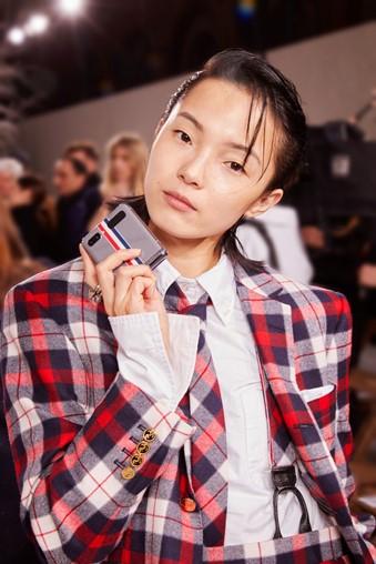 Model Xiao Wen Ju with Galaxy Z Flip Thom Browne Edition at Paris Fashion Week.