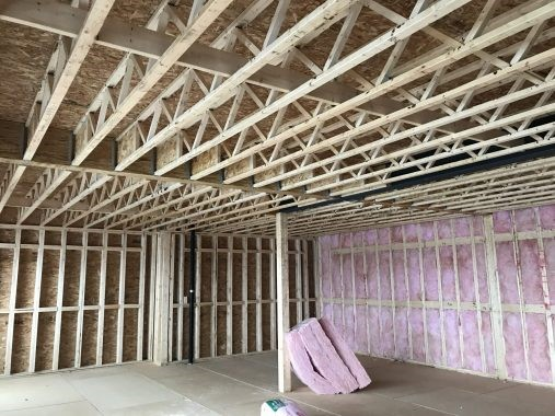 Advantages for builders to install strongbacks in an open web floor system