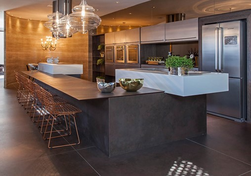 Large kitchen with stainless appliances and steel island.