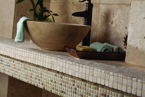 Bathroom counter with stone sink and counter top.