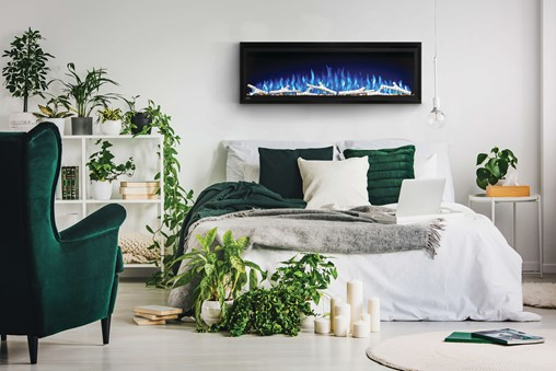 Napoleon Entice 50 with birch logs in a white and green bedroom