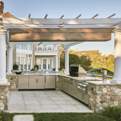 A Danver Outdoor Kitchen and a Walpole pergola make a beautiful pair.