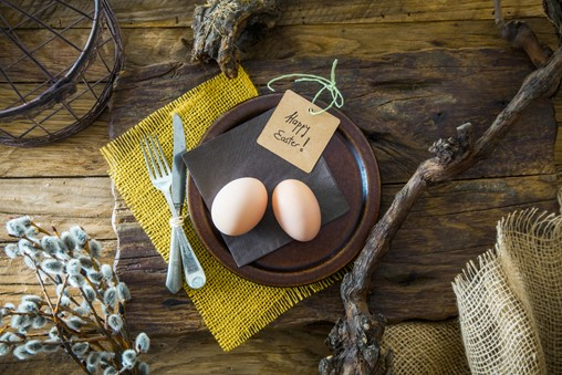 Easter table setting. Fresh eggs on plate. Spring table