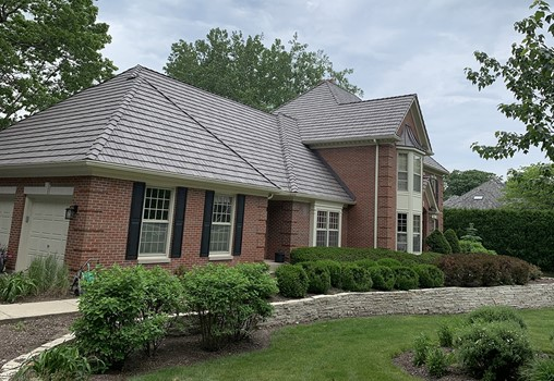 Brick Siding + Composite Shake Roofing = Low Maintenance Home Exterior
