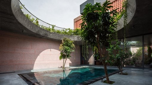 23o5studio completes textured Pink House in Vietnam