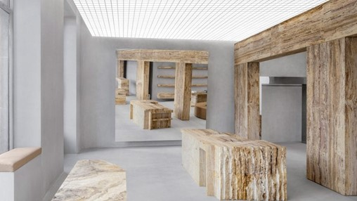 Halleroed inserts sculptural travertine display plinths in Axel Arigato's Paris store