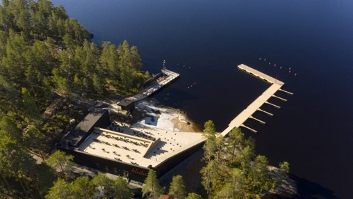Studio Puisto completes wellness centre that steps down towards a lake
